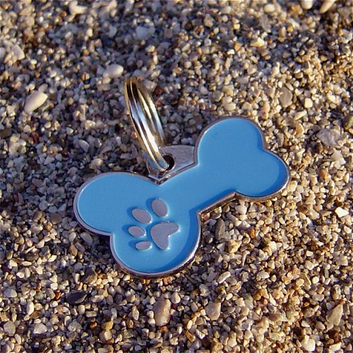 Custom personalized dog name tag BONE MJAVHOV BLUE Color: colored/silver  Dim: 34 x 21 mm Engraving area:  27 x 7 mm Metal, chrome plated pet tag.   Personalized laser engraving on the back side included.  Hand made  MADE IN SLOVENIA  In stock.
